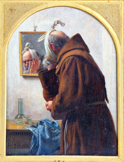 A Monk Examines Himself In A Mirror